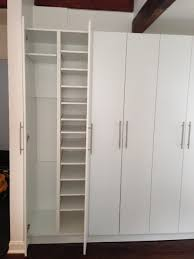 condo living room built in and storage unit modern wardrobe