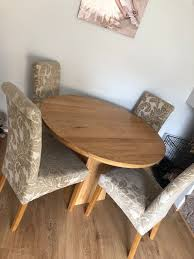 solid oak round table and 4 chairs