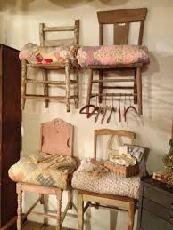 furniture display ideas. repurpose old chairs mount them on the wall and stack folded vintage quilts seats chair as quilt displays furniture display ideas s