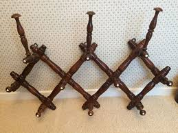 expandable wooden wall coat rack early 20th century france