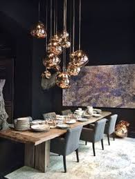 love the bold dark with the copper shiny globes mixed with the rustic wood glamorous yet attainable