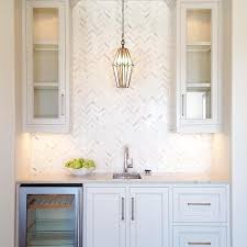 wet bar with mercury glass pendant and