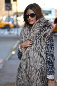 the mixing of textures with a tweed layer under a fur vest can work so well together especially if both items are neutral colors in many cases these days