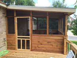 cedar enclosure with wood screen door
