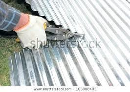 cutting corrugated metal cutting corrugated metal handyman contractor cutting iron with cutters home concept cutting corrugated cutting corrugated metal