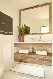 reclaimed bathroom furniture. Lovely Powder Room Features Reclaimed Wood Mirror Over Floating Vanity Paired With White Top And Wall-mounted Faucet Stacke Dover Bathroom Furniture B