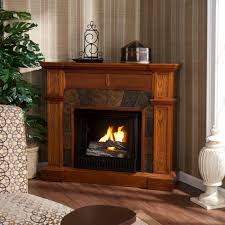 brown wooden fireplace tv stand with white urns and potted plantsplaced on brown laminated