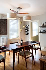 mid century modern fireplace dining room midcentury with wine accessories modern light fixture