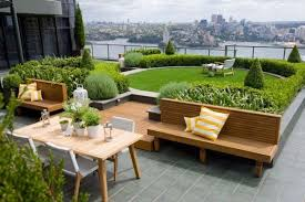 roof deck furniture. Furniture : Roof Terrace Patio Design With Green Garden Near Brown Wood Bench Seat Yellow Cushions Small Dining Table White Chairs Deck H