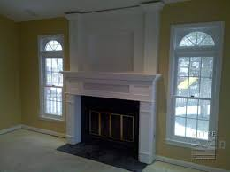tv on fireplace mantel startling imposing mantels surrounds mitre contracting interior design 39
