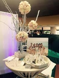 white freesia, orange mokara, orange protea in a cylinder vase Wedding Expo Maui beautiful silver tree centerpiece, custom made for the maui wedding expo wedding expo maine