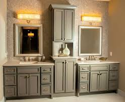 painted and glazed master bath vanity with double sinks and recessed linen cabinet