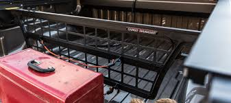 enable the divider to be conveniently positioned every 3 along the bed length without the necessity of walking to both sides of the truck