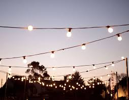 feast in the field is one of the style co s signature outdoor weddings featuring festoon