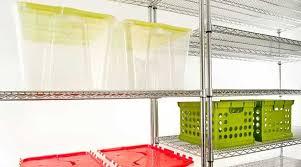 clear plastic storage bins on large metal shelves