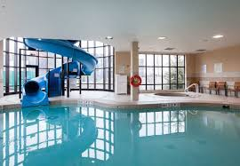 indoor pool with waterslide.  Indoor Find The Group Activity You Need To Keep Everyone Entertained And Relaxed  At Our Kingston Hotel With Pools An Indoor Pool Is A Fantastic Thing Do  Inside Indoor Pool With Waterslide Courtyard By Marriott