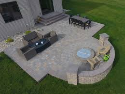 fire pit with seat wall and paver patio