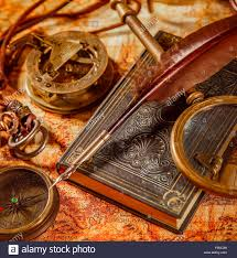 vine still life magnifying gl pocket watch old book and goose quill pen lying on an old map in 1565