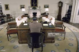 oval office chair. A Wide-angle View Of President Ronald Reagan Sitting At His Desk In The Oval Office Chair