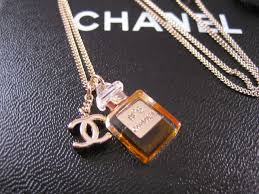 i m absolutely in love with this gold chanel necklace with miniature no 5 perfume bottle and cc logo pendants attached