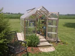 small home greenhouse designs mixed with wooden frames and transpa glass material with black iron