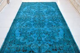 what is the over dyed rug the journey of over dyed rugs began in istanbul turkey during effors to revitalize old hand woven rugs