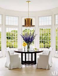 breakfast room furniture ideas. White-slipcovered Chairs Ring A Modern Table In The Bright Breakfast Area Of Tommy Mottola Room Furniture Ideas