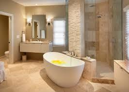 acrylic freestanding bathtub floating vanity white sink mirror beige countertop wall sconces mounted tub filler shower