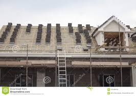 Apartment Building Working On The Roof Sheeting And Outriggers Or Ladder Of New Two Story Commercial Apartment Building In The Uk Nordic Trust Homes Working On The Roof Sheeting And Outriggers Or Ladder Of New Two
