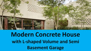 Modern Concrete House With L Shaped Volume And Semi Basement - House with basement garage