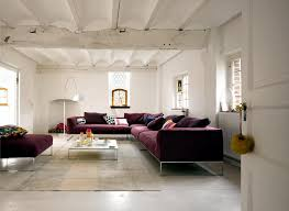wine red sofa in a white room