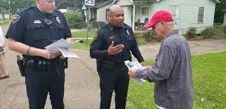 Image result for police officer helping community