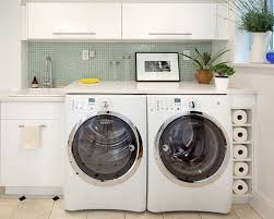 laundry room cabinetry design with wall mounted cabinet and washing