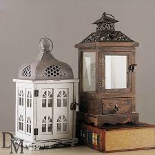 white and brown distressed wood metal lanterns outdoor