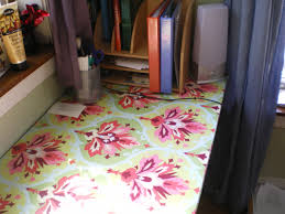 had a love affair with oilcloth for years but i seldom find a great use for it its so much more than a picnic tablecloth i had the idea of covering cover desk