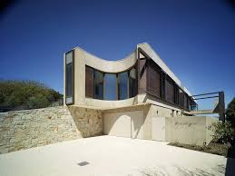 view in gallery modern beach house with curved window wall 3