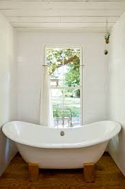 a custom bath tub builder will be able to fabricate their tubs to your required measurements a free standing tub will give the space a more modern feel