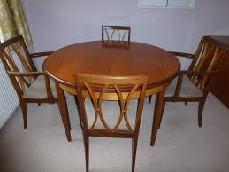 g plan teak round dining table with 2 carver chairs and 2 dining chairs