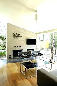 mid century fireplace painted screen living room with modern furniture gray brick white canvas cent