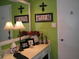 My lime green bathroom with black, white and red accents. My husband framed  out