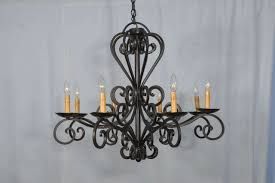hand wrought iron spanish chandelier consisting of graceful curves from top to bottom eight