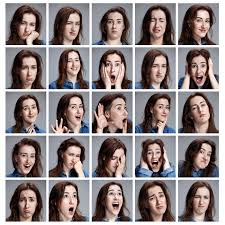 a photograph set of a young woman s portraits with diffe emotions on a grey background
