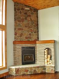 designing a corner fireplace with stone veneer adds a cozy mountain feel