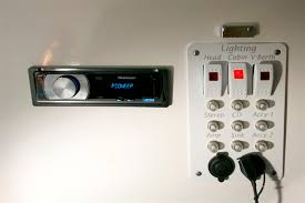 cabin audio and lighting controls with ipod attachment and 12 volt