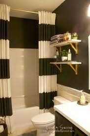 gold and white bathroom accessories. black \u0026 white guest bath reveal - like the striped curtain and gold shelf brackets bathroom accessories e