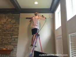 step 5 you will need something to space your boards to create the shiplap look we experimented around with several diffe things before we found the
