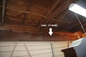 sagging garage door header
