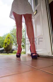 Woman Walking Through The Front Door Stock Photo Picture And