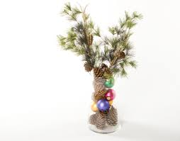 Make your own tree from branches and cones!