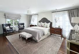 grey area rugs with traditional bedroom and white bedding tufted grey chair dark wood nightstand gray area rug grey traditional area rug
